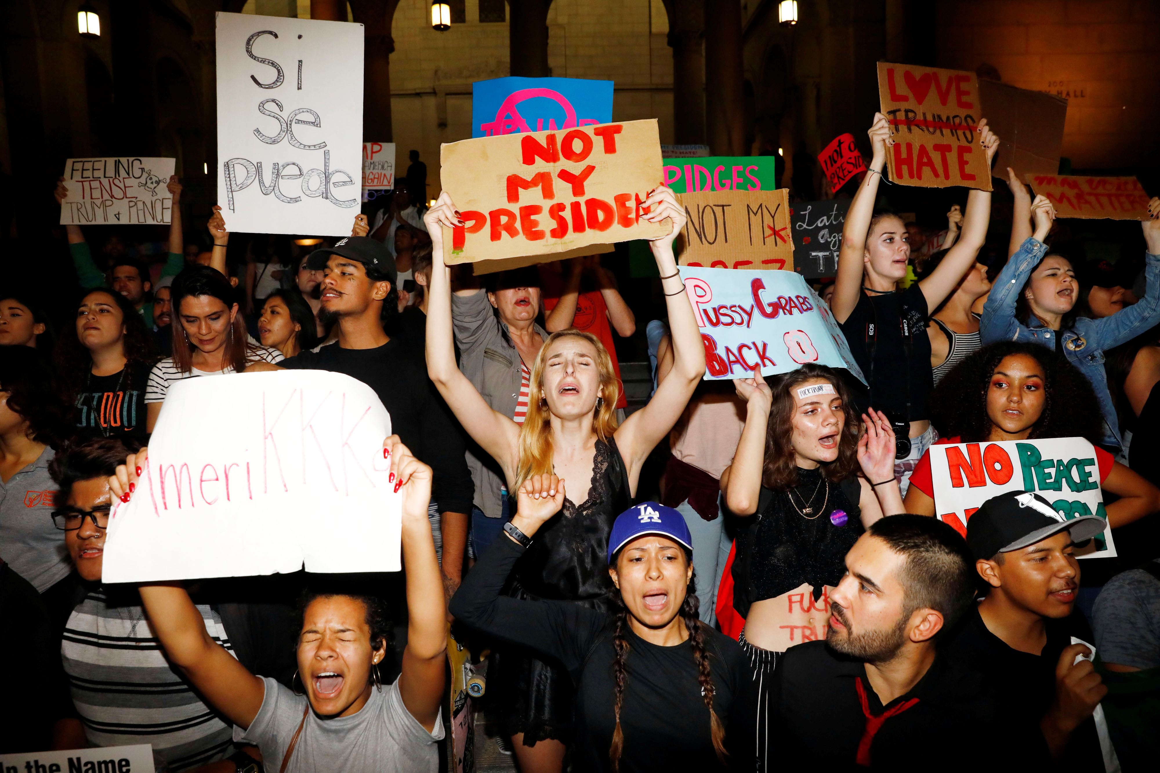 Demonstrators protest outside of City Hall following the election of Republican Donald Trump as President of the United States in downtown Los Angeles, California